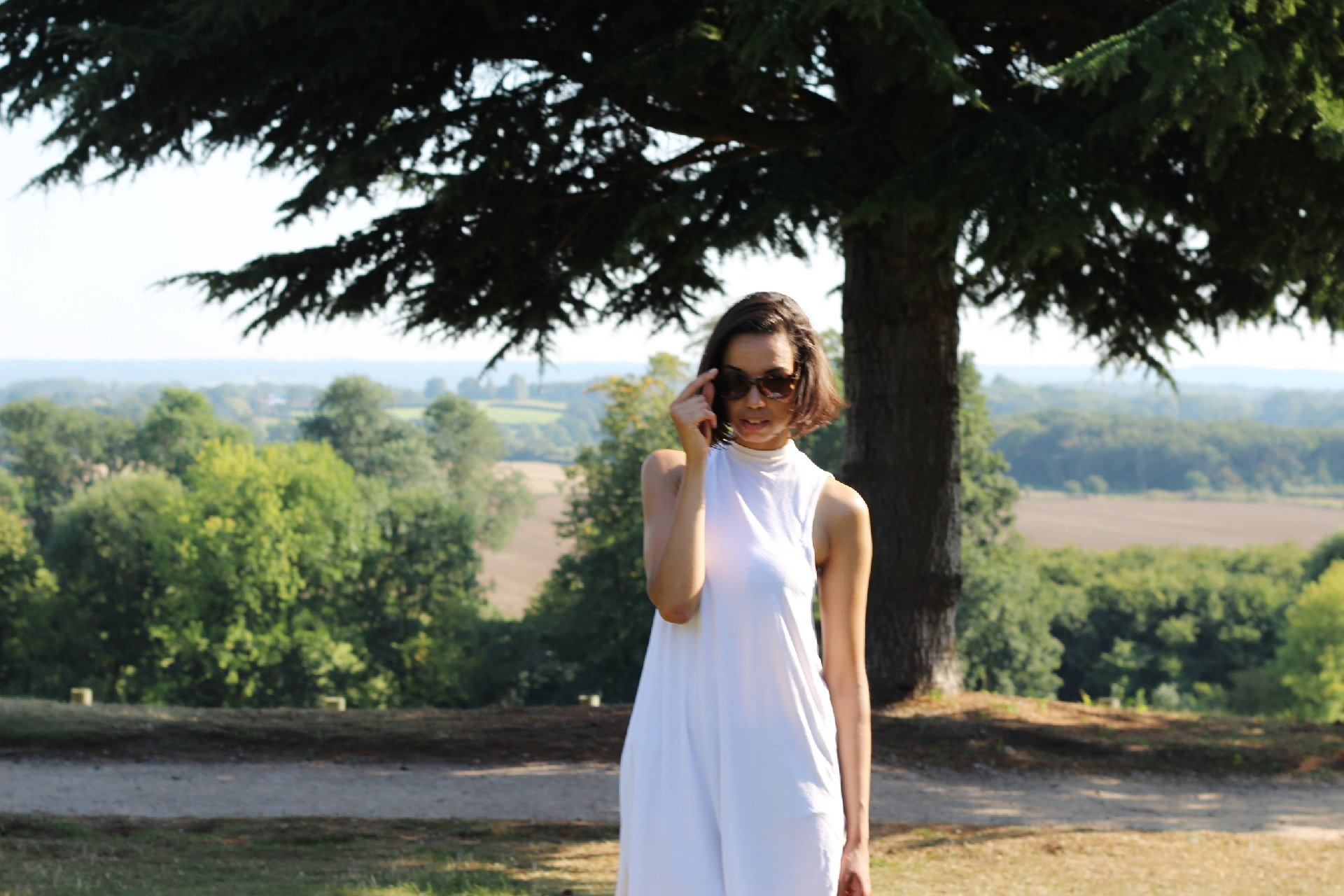 unsolicited advice - girl posing in front of tree - The Style of Laura Jane